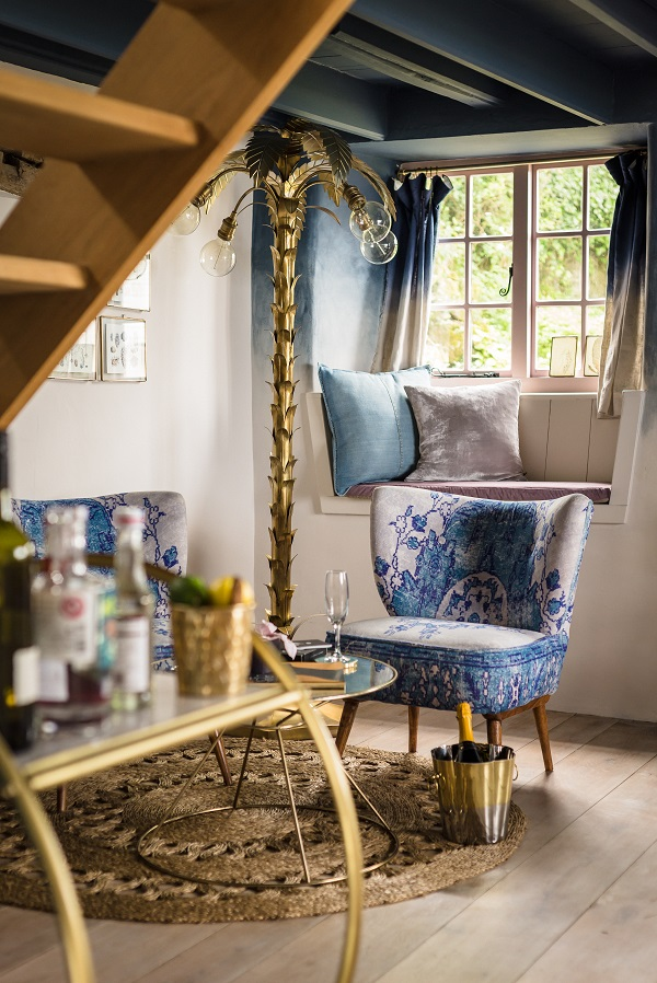 Glam furnishings in a boho-chic cottage
