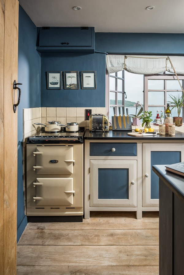 The blue kitchen in a romantic boho-chic cottage