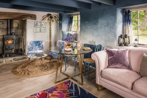 A roaring woodburner in a boho-chic cottage