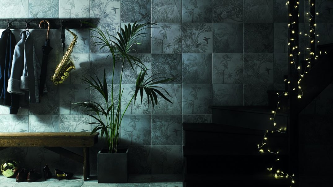 Green and tropical tiles rocking it in a hallway