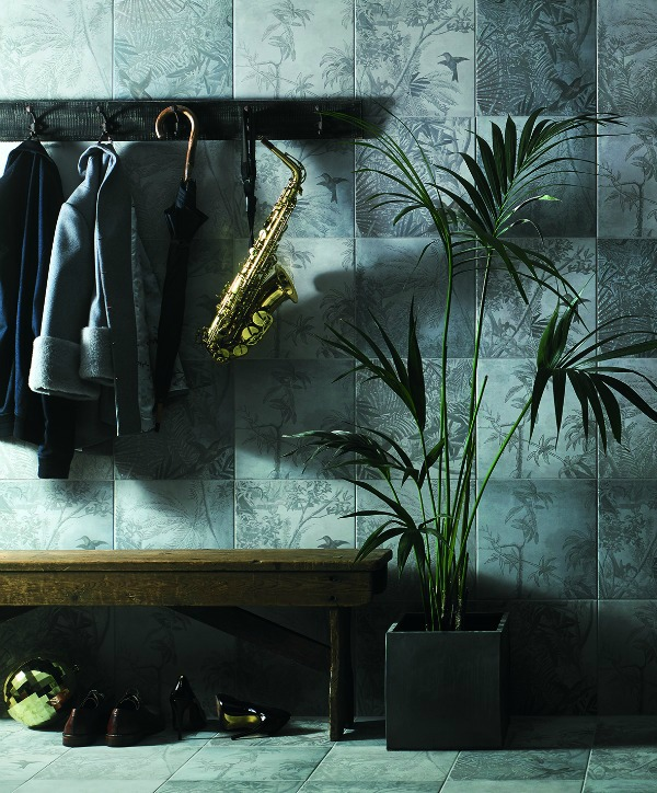 botanical tiles rock on walls and floor in an entryway