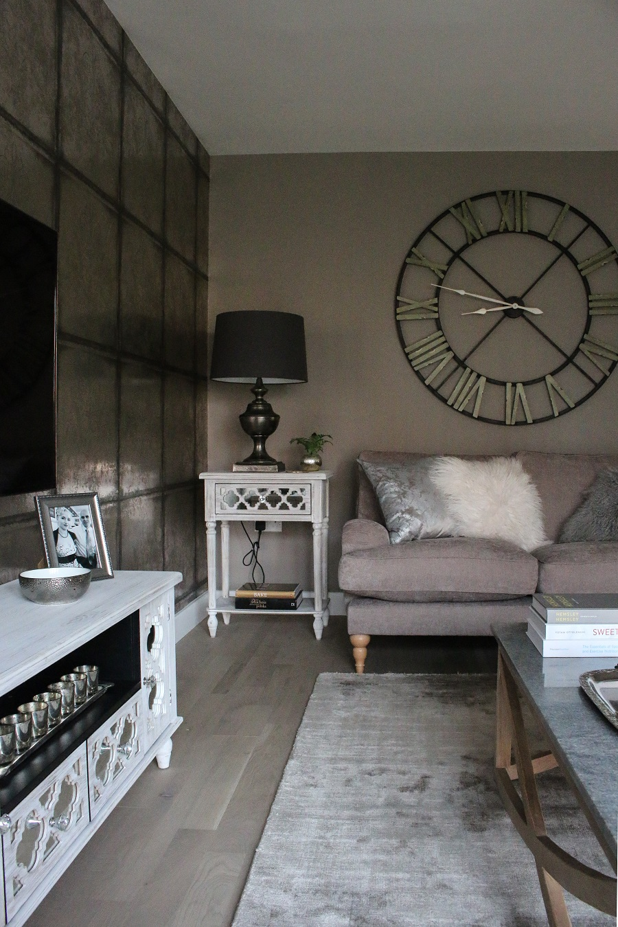 Texture, decorative furniture and silver accents in a neutral and warm living room