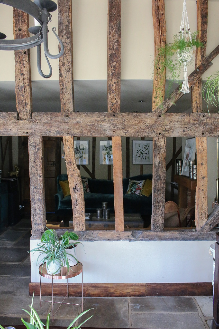 sunroom original beams in an old barn with a boho vibe