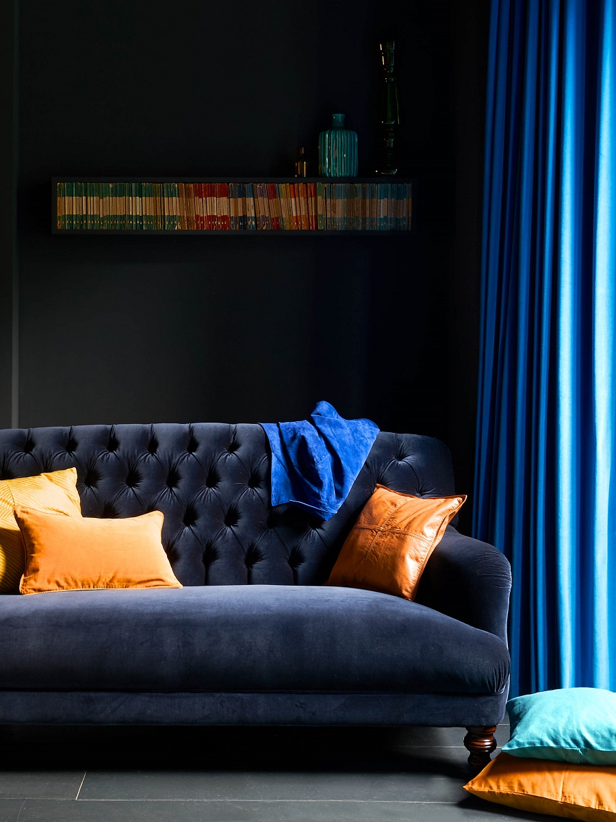 Exploring the Sophisticated Side of Navy Blue in the Home - dark walls and navy velvet