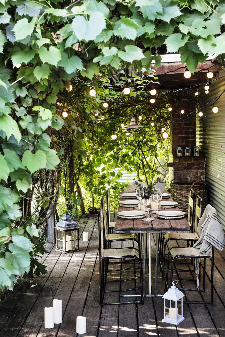 Fairy Lights are not just for Christmas - use string lights to add ambiance to a shady pergola