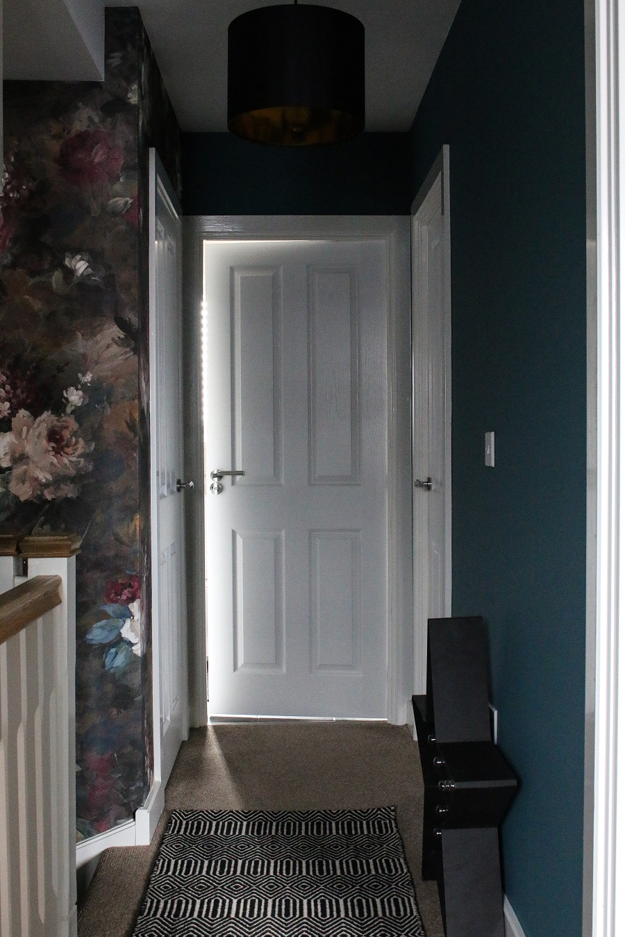 Hall and stairs reveal - black and white runners, floral wallpaper, teal paint