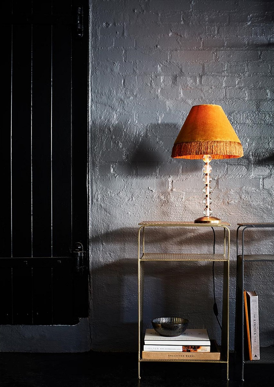 Table lamp with fringe benefits