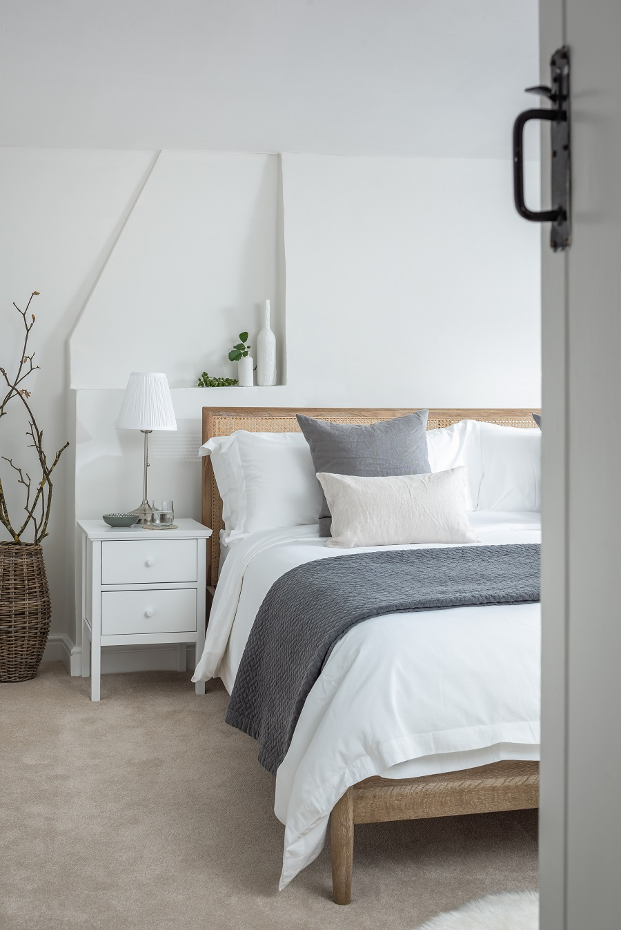 If the ceiling is too low for fitted wall units, put up a shelf instead. I happen to prefer this in rooms that do have enough ceiling height too. Keep the cottage theme going with wooden worktops, metro wall tiles and handy baskets.